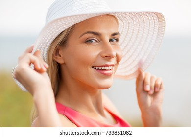 summer, fashion and people concept - portrait of beautiful smiling woman in sun hat