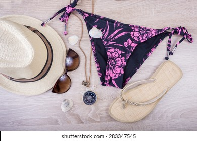 Summer fashion woman stuff on wooden background