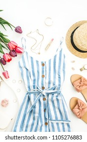 Summer female fashion stylish composition. Dress, slippers, straw, tulip flowers on white background. Flat lay, top view clothes and accessories collage.