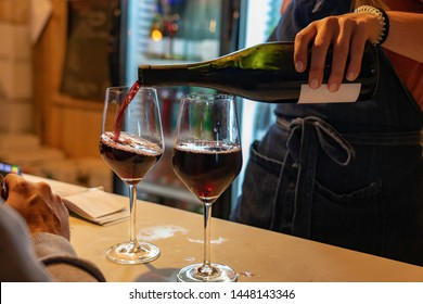 summer festival event with light and two glasses of red wine wine festival poor from a bottle