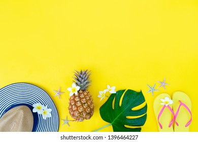 Summer flat lay vacational border with green leaves, cocnut and shoes with copy space
