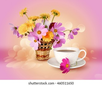summer flowers and a cup with a drink on a bright background of the warm