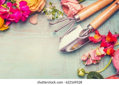 Summer flowers and gardening tools on vintage shabby chic background, top view, copy space