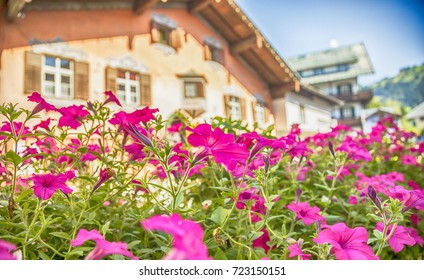 summer flowers and wooden house in village Kitzbuhel , Austria