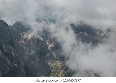 Summer fog on the peak of Marmolada mountain