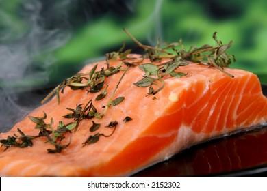 Summer food, rose colored fish steak in a wine marinade macro closeup