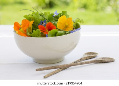 Summer fresh flowers salad in bowl