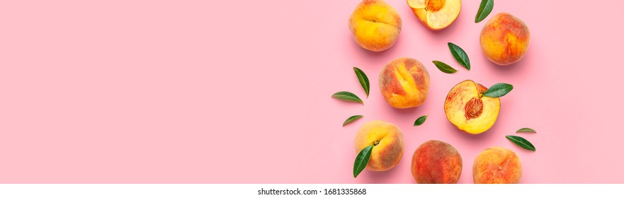 Summer fruit background. Flat lay composition with peaches. Ripe juicy peaches with green leaves on pink background. Flat lay top view copy space. Fresh organic fruit vegan food. Harvest concept