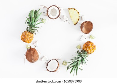 Summer fruit composition. Pineapples, coconuts on white background. Fruit background. Summer concept. Flat lay, top view, copy space