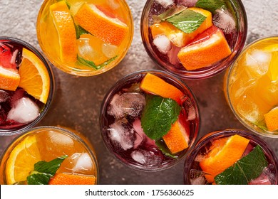 Summer fruit drinks and ice water, top view