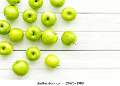 summer fruit pattern with apples on light wooden background top view copyspace