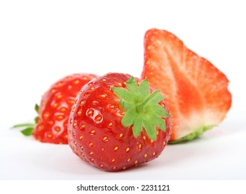 Summer fruit salad ingredients, sliced strawberries, macro close with copy space