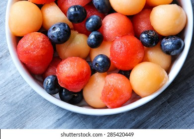 Summer Fruit salad with strawberries, mangoes,water melon and blueberries, close up overhead view