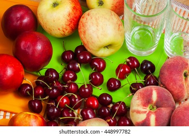 Summer fruits and glasses for making fresh juice.