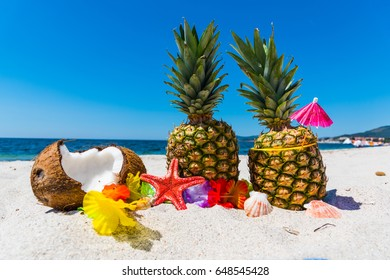 Summer fruits on the sand by the sea