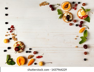 Summer fruits on white background with empty space