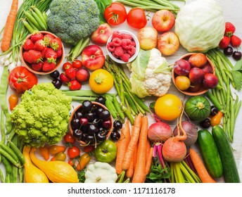 Summer fruits vegetables berries background, apples cherries peaches strawberries cabbage broccoli cauliflower squash tomatoes carrots spring onions beetroot, copy space, top view, selective focus