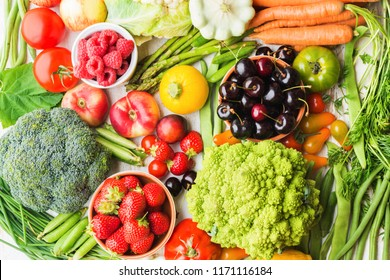 Summer fruits vegetables berries background, apples cherries peaches strawberries cabbage broccoli cauliflower squash tomatoes carrots spring beetroot, copy space, top view, selective focus