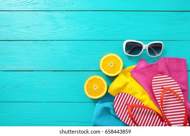 Summer fun. Fruits and accessories on blue wooden background. Top view and copy space. Mock up and picturesque. Fashion and beauty. Travel