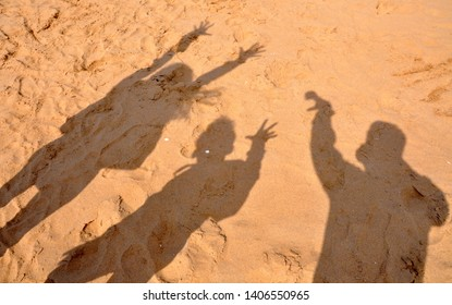 Summer fun. A happy family having fun against sunset beach.Shadow of a beautiful family enjoying on beach. shadow of man woman and boy on a sea shore