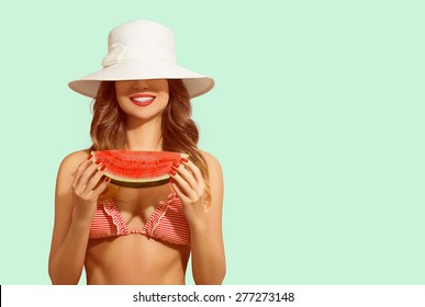 Summer fun, happy woman covers face with hat, holding water melon and smiling. Concept of vacation, healthy eating, diet.