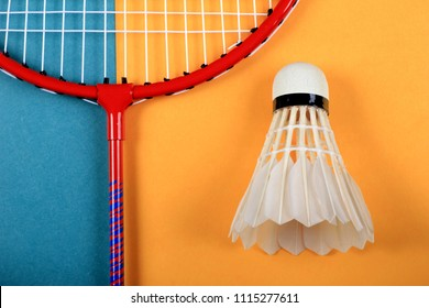 Summer fun minimal concept. Top view on badminton racket and shuttlecock. Sport. Pastel colours background.  Flat lay, mock up and copy space. Trendy colors.