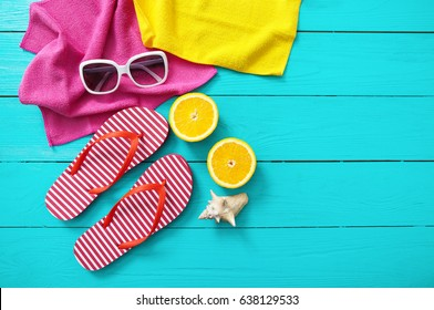 Summer fun time and accessories on blue wooden background. Mock up and picturesque