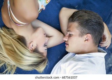 Summer fun. Top view of a young couple in love lying together on the grass