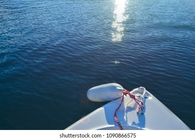 Summer fun weekend boating on the lake background. Peaceful and calm water ripples. Sunshine reflecting on water.