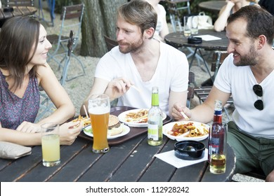 In summer garden � friends drinking beer and eating
