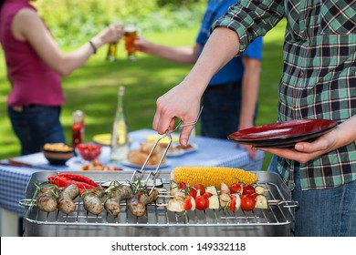 A summer garden party with grilled snacks and drinks