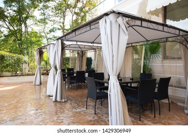 Summer Garden Retreat. Arbor tent in the territory of the center of rest with coffee table and chairs