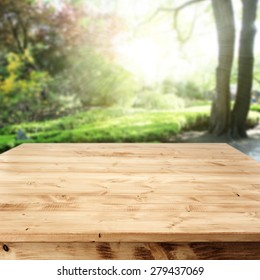 summer garden of sun light and desk of wood and space for your decoration