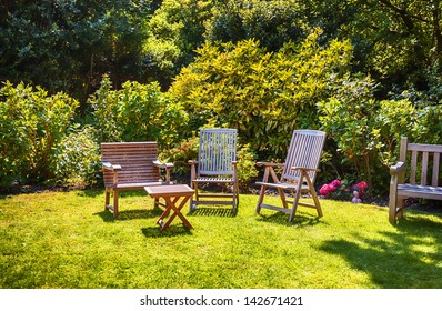 summer garden with wooden furniture