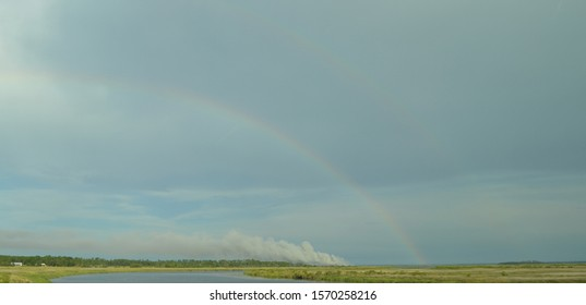 Summer in Georgia: Double Rainbow and Smoke over the wetlands near Brunswick