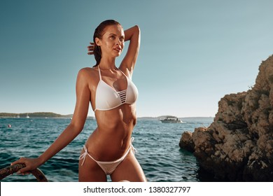 Summer girl in a bikini on the seashore