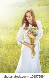 Summer girl with chamomile bouquet