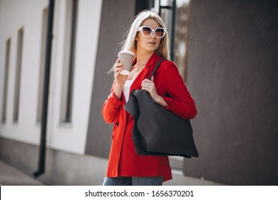 Summer girl posing with bags outside the city