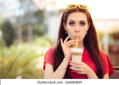 Summer Girl and Sipping Coffee Drink Trough a Straw - Funny woman at a restaurant in summertime