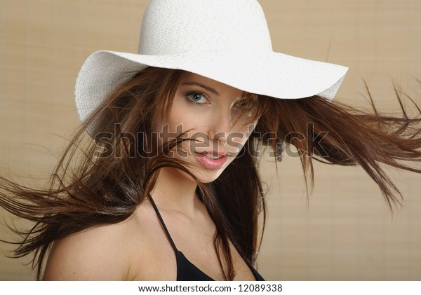 Summer girl wearing a white hat