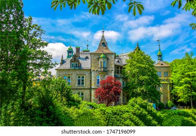 Summer green castle park garden. Castle manor in summer