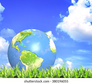 Summer green grass, blue sky, clouds and Earth. Elements of this image furnished by NASA