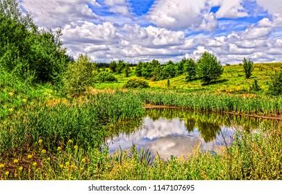 Summer green nature river landscape. Cloudy sky river summer view. Summer nature green river scene