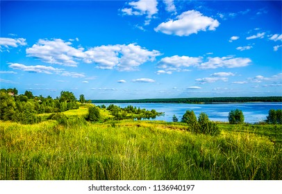 Summer green nature river shore landscape. River shore in summer nature scene. Summer river shore panorama