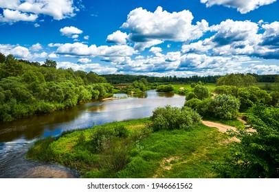 Summer green nature river sky clouds landscape. Summer river nature panorama. Clody sky nature river landscape in summer