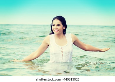Summer happy woman in water