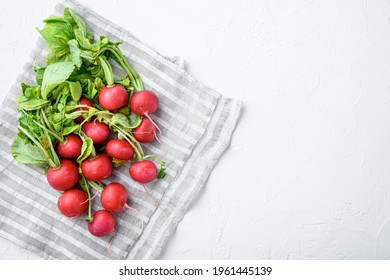 Summer harvested red radish. Growing organic vegetables. Large bunch of raw fresh juicy garden radish set, on white stone background, top view flat lay, with copy space for text