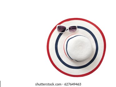 Summer hat and sunglasses isolated on white background. Top view and copy space.