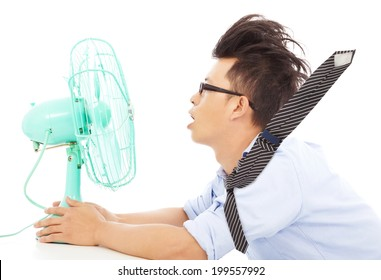 Summer heat, business man use fans to cool down