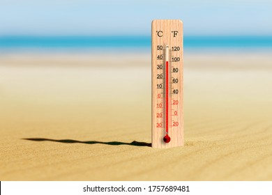 Summer heat. Thermometer on the beach shows plus 38 degrees celsius. Summer travels and holidays